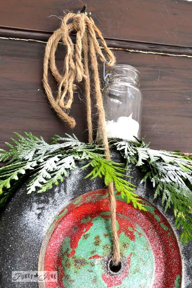 Tealight in a mini mason jar on wreath /  Junk wheel Christmas wreaths via https://www.funkyjunkinteriors.net/