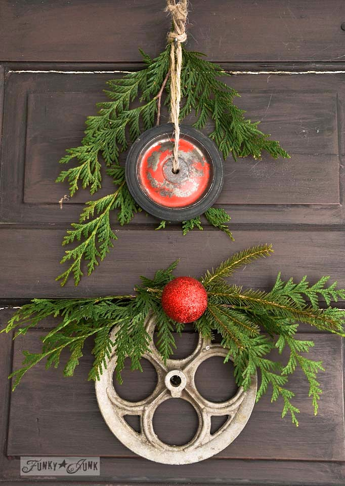 Red wagon wheel and wash-line wheel for junk wreaths /  Junk wheel Christmas wreaths via http://www.funkyjunkinteriors.net/