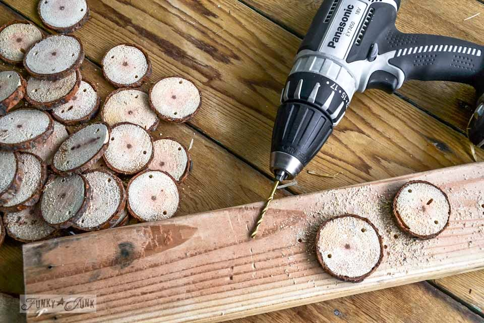 drilling holes into wood rounds / Cool and quirky fuzzy wood round and metal washer Christmas garland via https://www.funkyjunkinteriors.net/