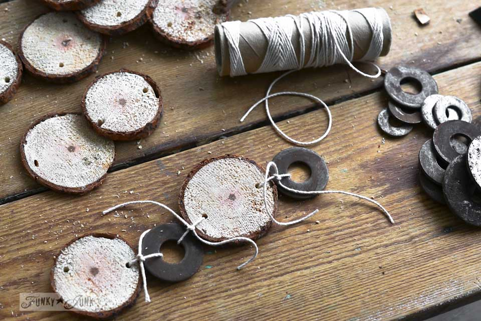 Tied wood rounds and washers with string / Cool and quirky fuzzy wood round and metal washer Christmas garland via https://www.funkyjunkinteriors.net/