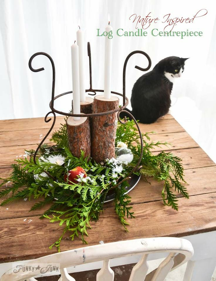 Nature inspired firewood log Christmas candle centrepiece via https://www.funkyjunkinteriors.net/