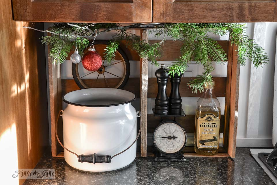 Crate and enamel pail in kitchen / A well lit junky Christmas kitchen / salvaged finds used to deck out this kitchen for Christmas via http://www.funkyjunkinteriors.net/