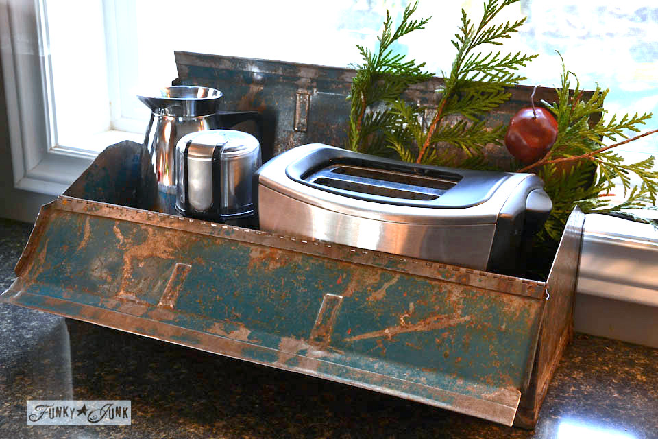 Toolbox storage in the kitchen / A junky Christmas kitchen / salvaged finds used to deck out this kitchen for Christmas via http://www.funkyjunkinteriors.net/
