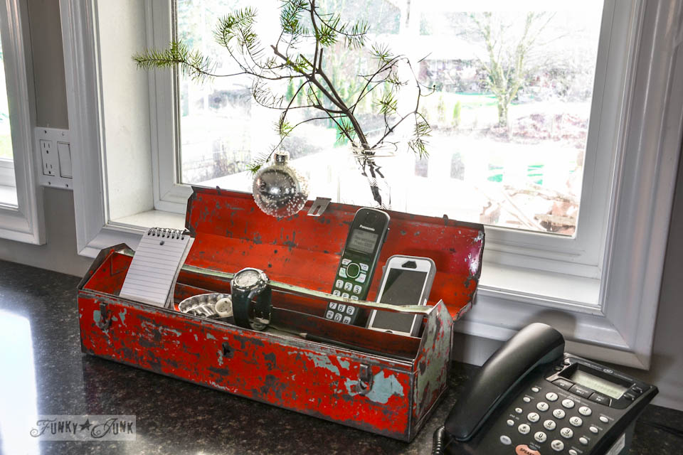 Red toolbox charging station / A well lit junky Christmas kitchen / salvaged finds used to deck out this kitchen for Christmas via https://www.funkyjunkinteriors.net/
