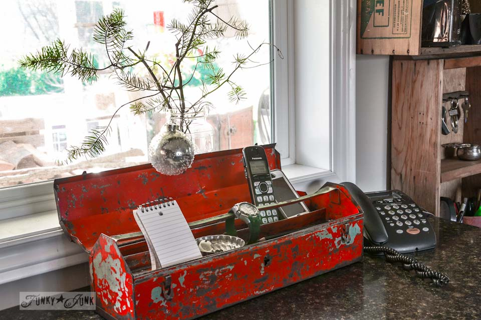 Red toolbox charging station / A well lit junky Christmas kitchen / salvaged finds used to deck out this kitchen for Christmas via http://www.funkyjunkinteriors.net/