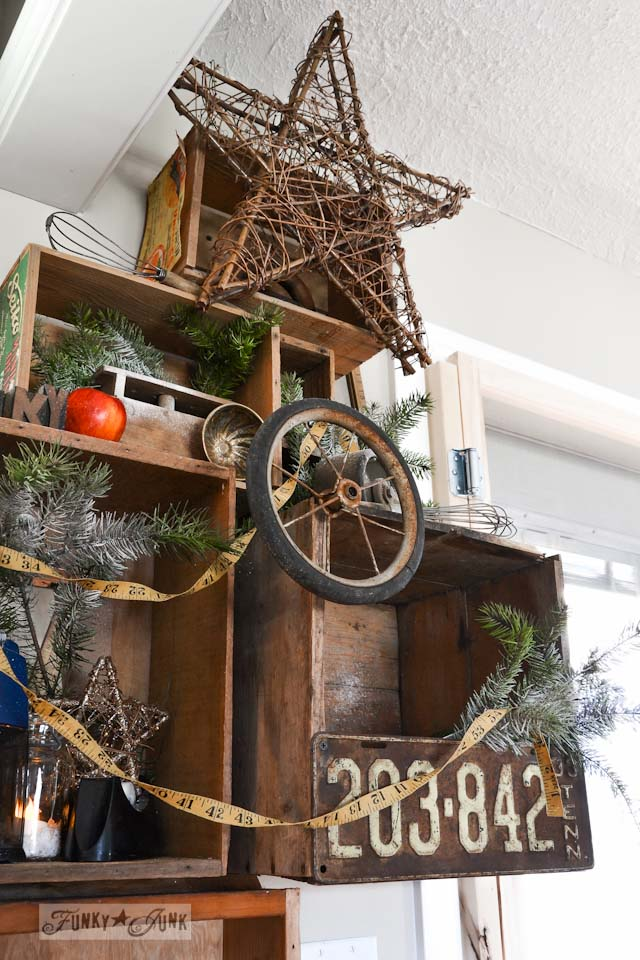 A well lit junky Christmas kitchen / salvaged finds used to deck out this kitchen for Christmas via http://www.funkyjunkinteriors.net/