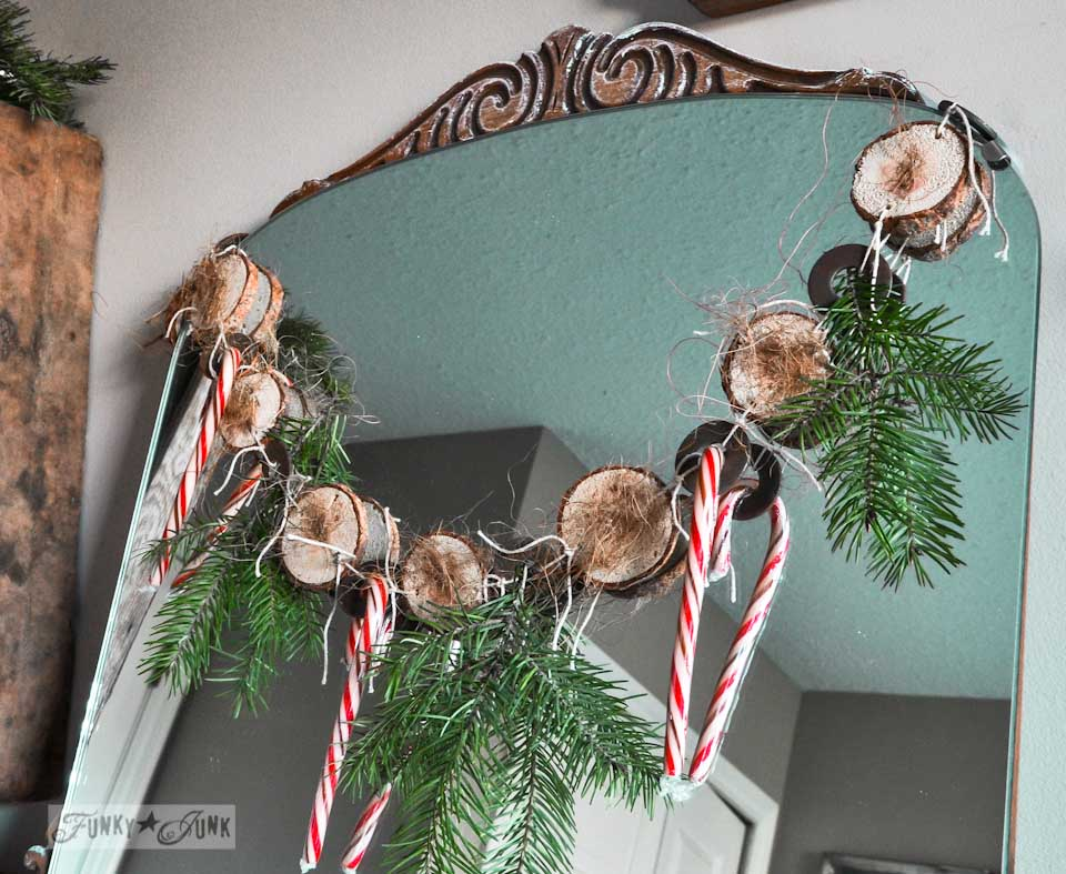 Cool and quirky fuzzy wood round and metal washer Christmas garland via https://www.funkyjunkinteriors.net/