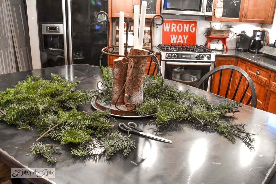 A log candle centrepiece / A junky Christmas kitchen / salvaged finds used to deck out this kitchen for Christmas via https://www.funkyjunkinteriors.net/