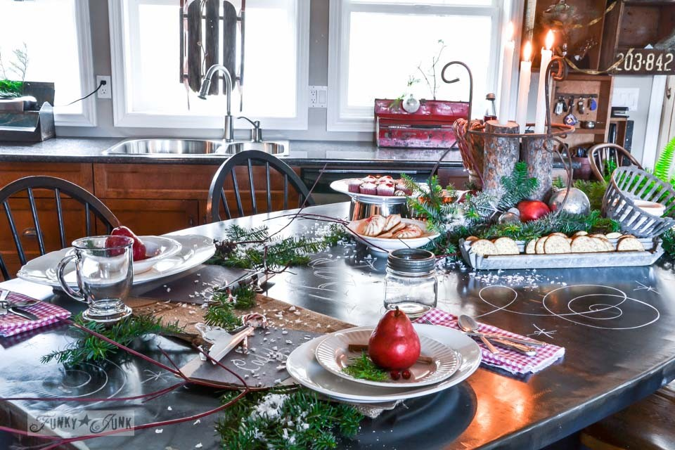 Black metal kitchen island decked out with Christmas food / A junky Christmas kitchen / salvaged finds used to deck out this kitchen for Christmas via https://www.funkyjunkinteriors.net/