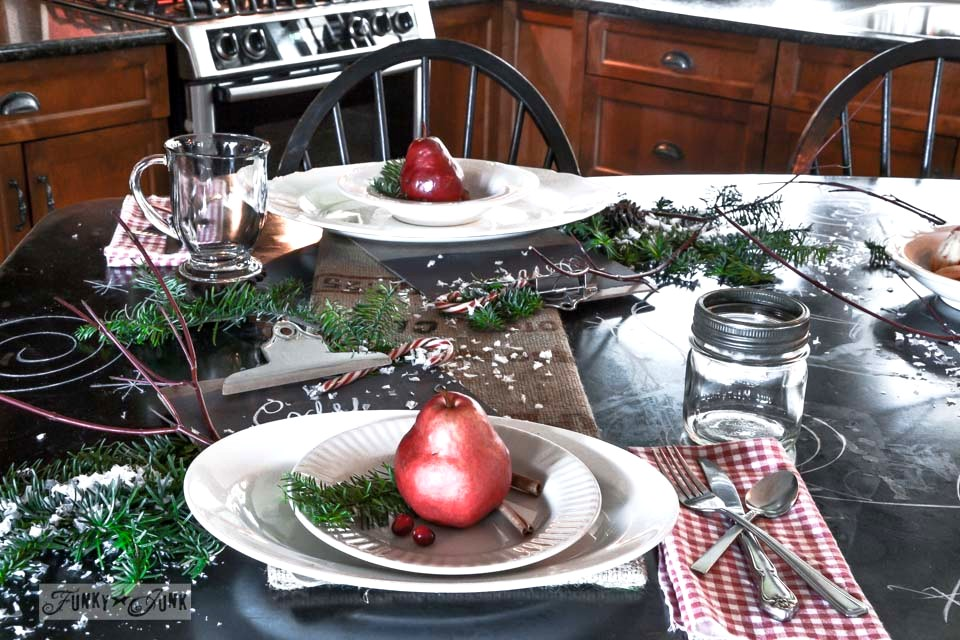 Black metal kitchen island decked out with Christmas food / A junky Christmas kitchen / salvaged finds used to deck out this kitchen for Christmas via http://www.funkyjunkinteriors.net/