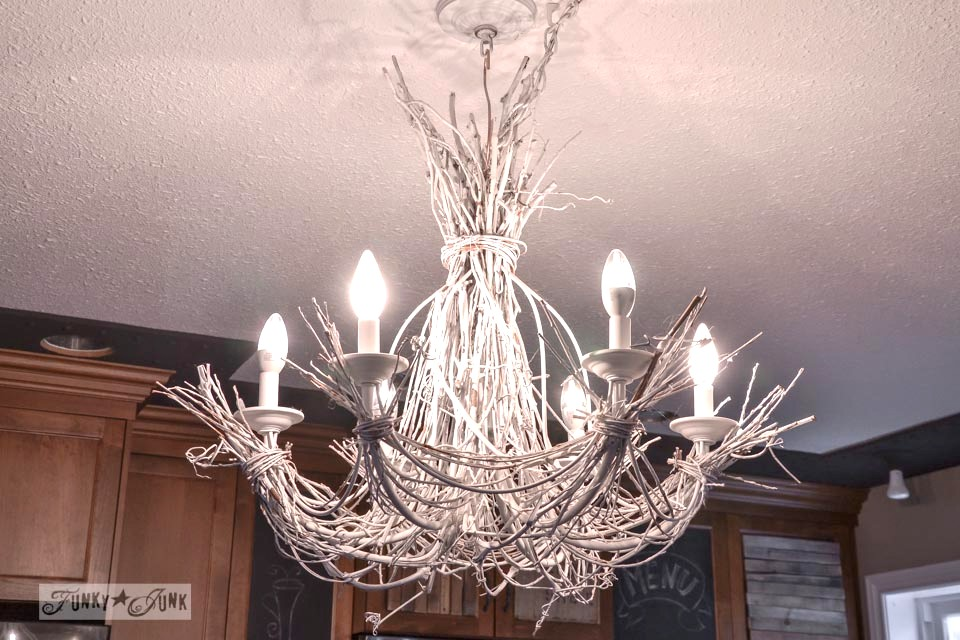 White twig chandelier /A junky Christmas kitchen / salvaged finds used to deck out this kitchen for Christmas via https://www.funkyjunkinteriors.net/