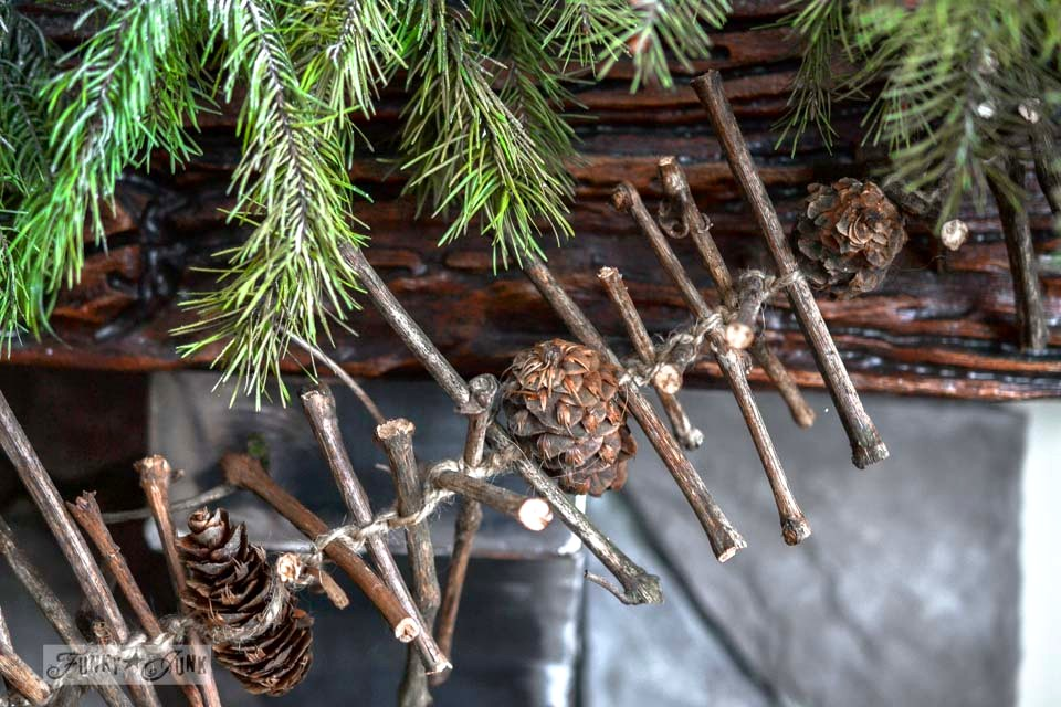 Grapevine pinecone twig garland / Illuminated old windows Christmas mantel via https://www.funkyjunkinteriors.net/
