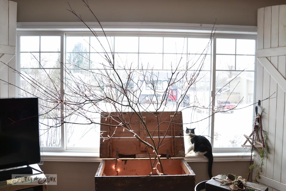 Make a winter tree from tree branches via https://www.funkyjunkinteriors.net/