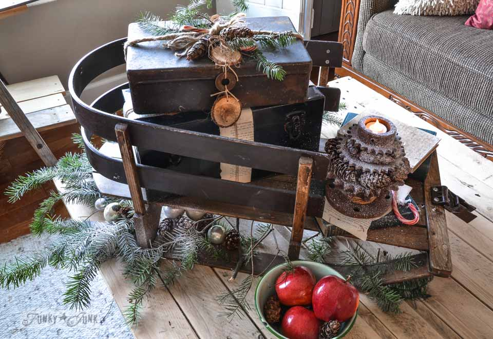 Toolbox presents on a vintage sleigh / Funky Junk Interiors Christmas Home Tour 2013 via https://www.funkyjunkinteriors.net/