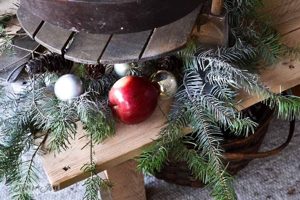 Decorating with evergreens and apples / Funky Junk Interiors Christmas Home Tour 2013 via https://www.funkyjunkinteriors.net/