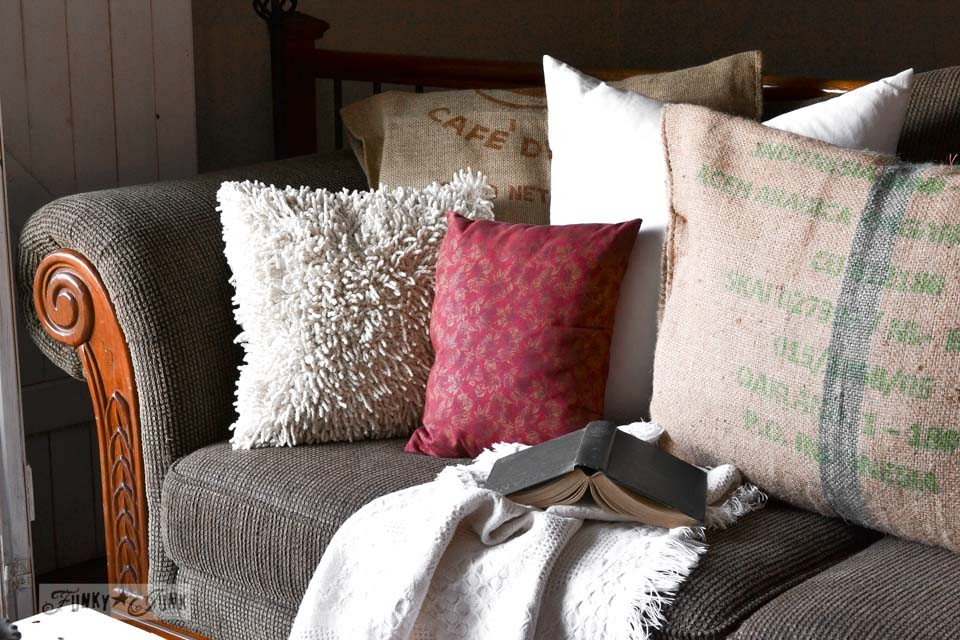 Sofa with burlap coffee bean bag pillows / Funky Junk Interiors Christmas Home Tour 2013 via https://www.funkyjunkinteriors.net/