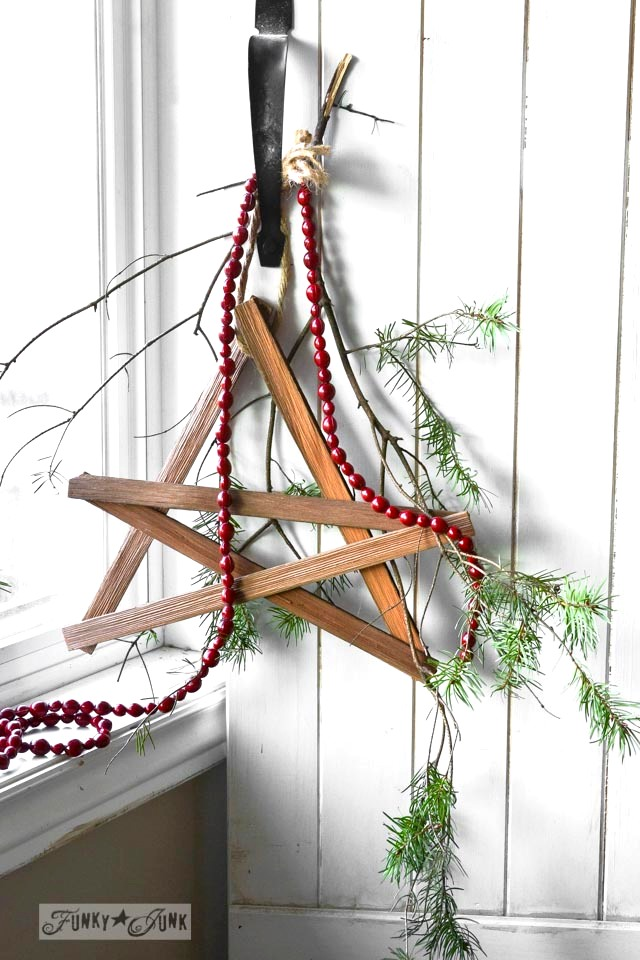 Firewood kindling star with cranberry beads / Funky Junk Interiors Christmas Home Tour 2013 via https://www.funkyjunkinteriors.net/