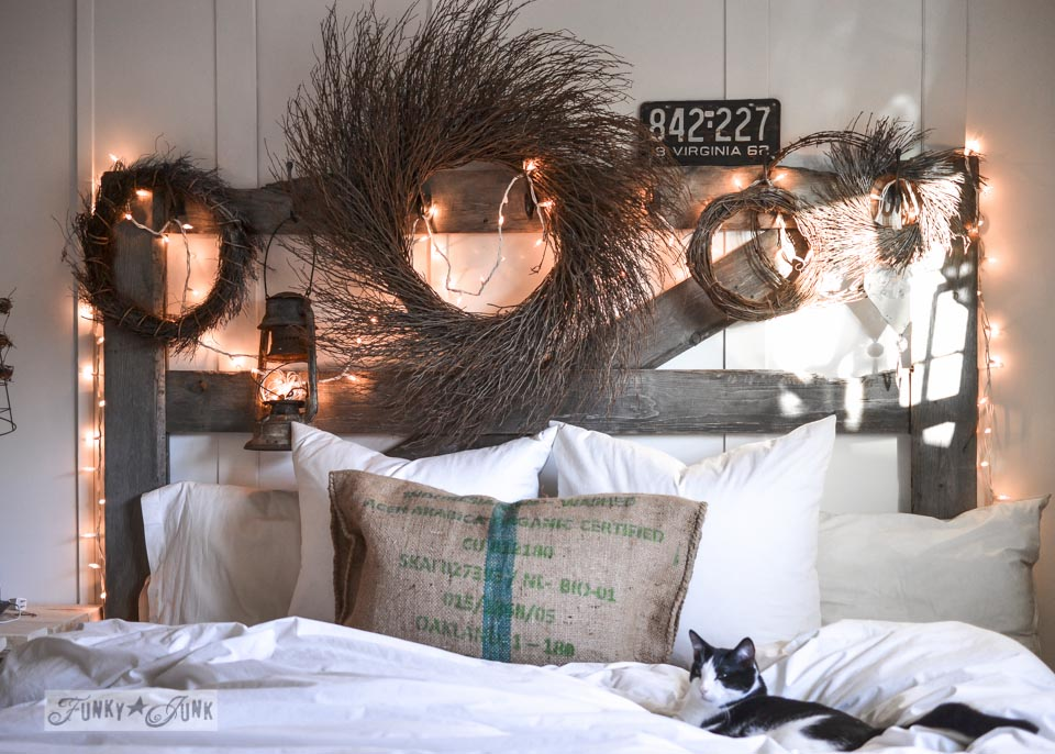 Rustic wreaths on an illuminated old gate headboard with cat photobomb / When cats photobomb via FunkyJunkInteriors.net