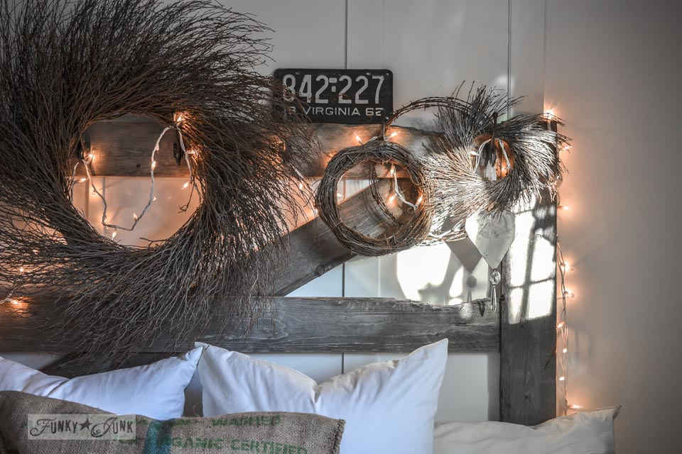 Horse gate head board with wreaths / Funky Junk Interiors Christmas Home Tour 2013 via https://www.funkyjunkinteriors.net/