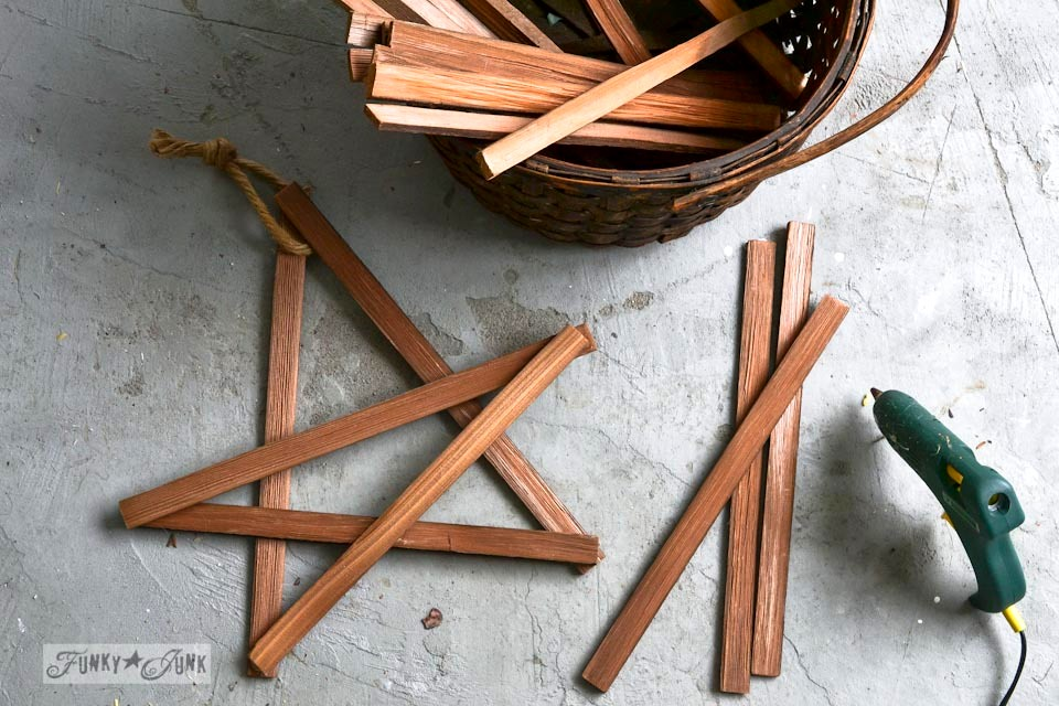 Hot gluing kindling stars together / Make Christmas kindling stars... in minutes! via https://www.funkyjunkinteriors.net/