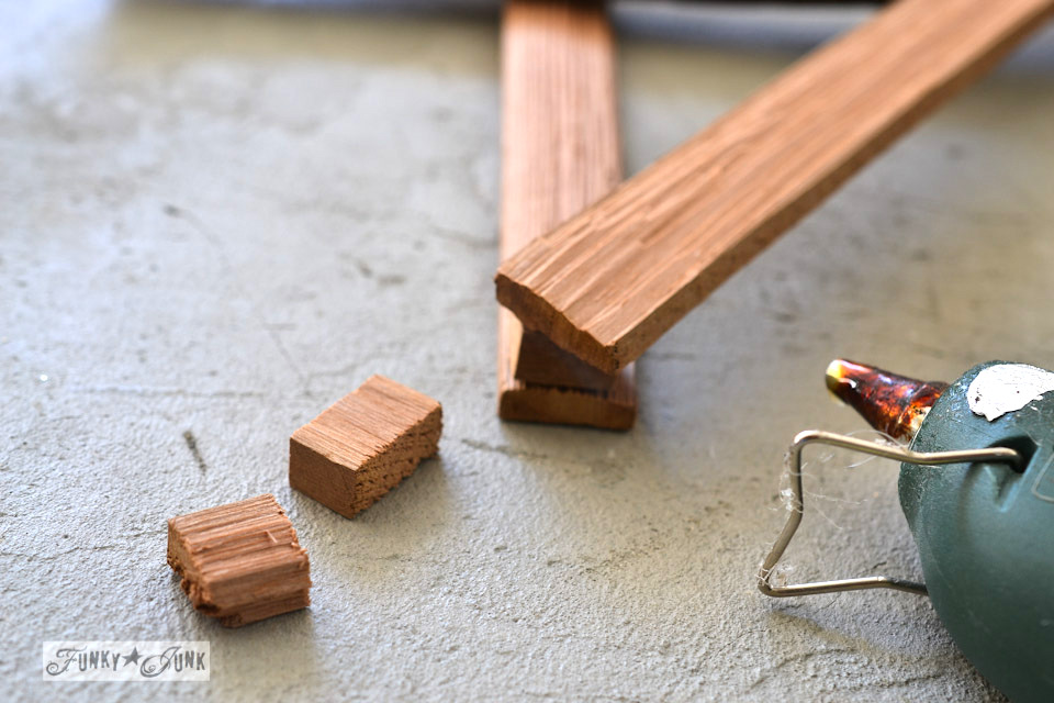 Adding a wooden spacer to the stars / Make Christmas kindling stars... in minutes! via https://www.funkyjunkinteriors.net/
