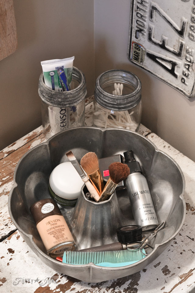 Antique cake pan and mason jars for makeup storage / A little new old upcycled bathroom organizing via https://www.funkyjunkinteriors.net/