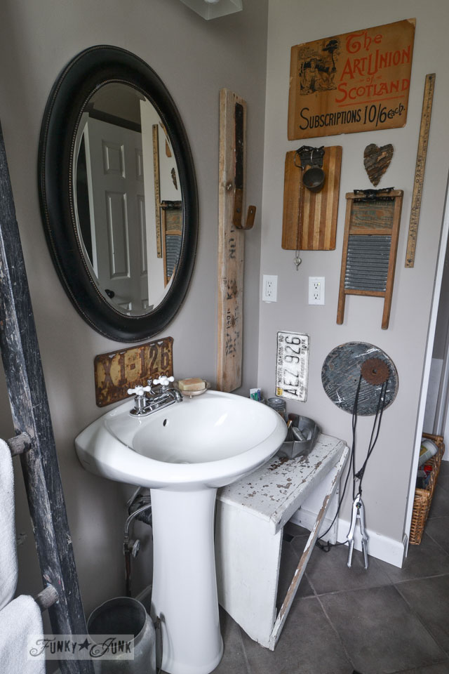 Upcycled wall gallery in bathroom /  A little new old upcycled bathroom organizing via http://www.funkyjunkinteriors.net/