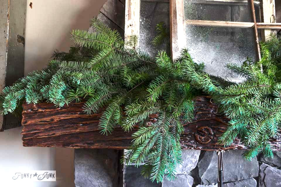 Layered evergreen branches / Illuminated old windows Christmas mantel via https://www.funkyjunkinteriors.net/