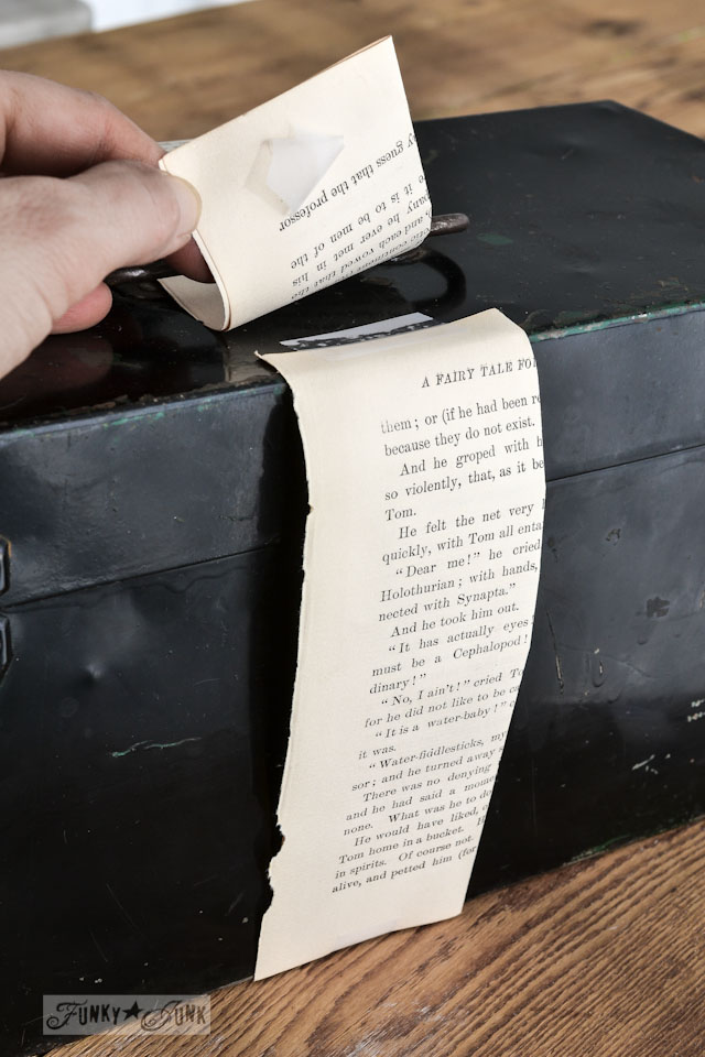 Creating book page ribbon onto Rusty toolbox pretend Christmas presents via https://www.funkyjunkinteriors.net/
