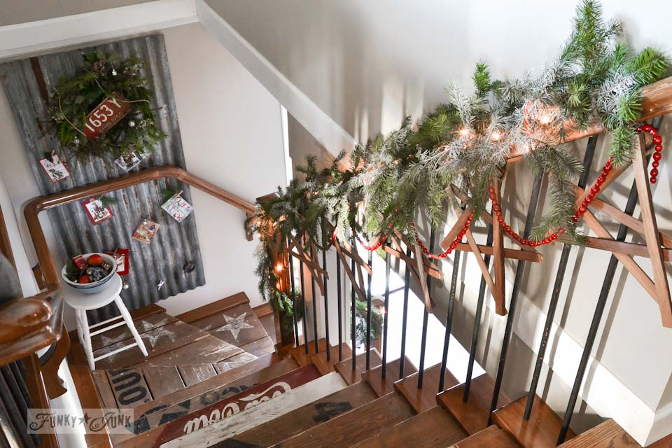 Christmas stairway rail with wooden stars / Funky Junk Interiors Christmas Home Tour 2013 via https://www.funkyjunkinteriors.net/
