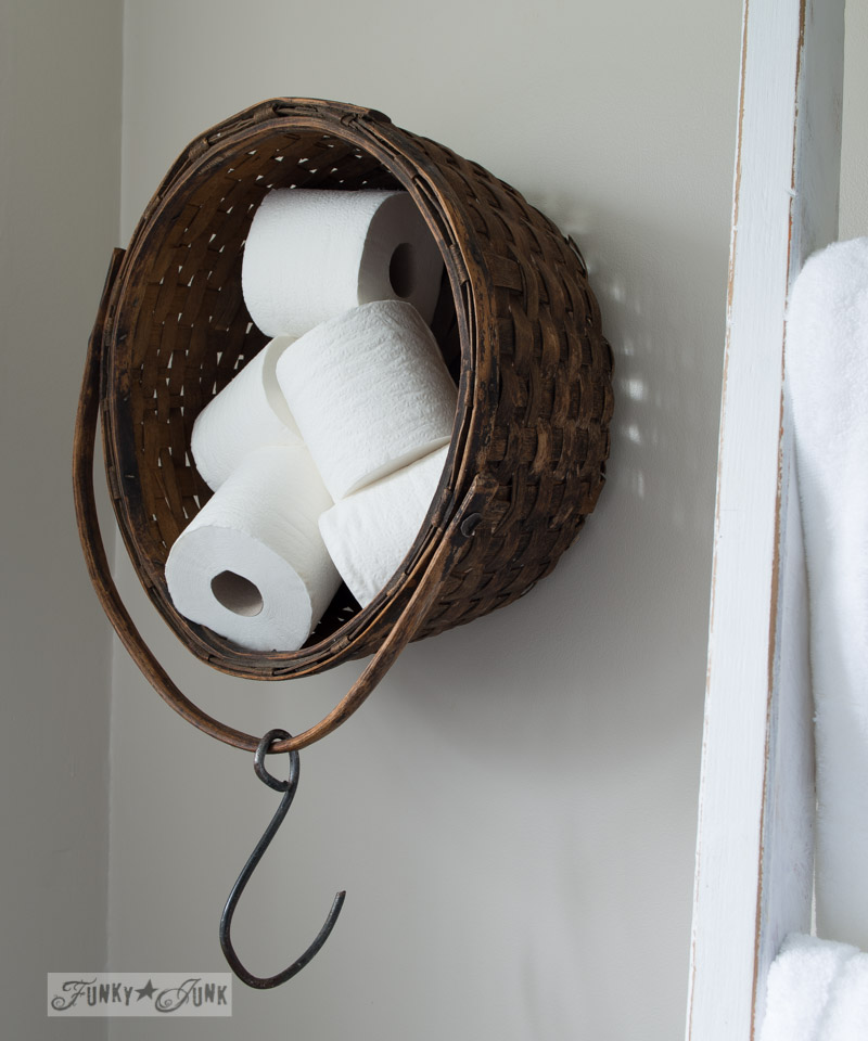 Toilet paper holder basket on a wall via FunkyJunkInteriors.net