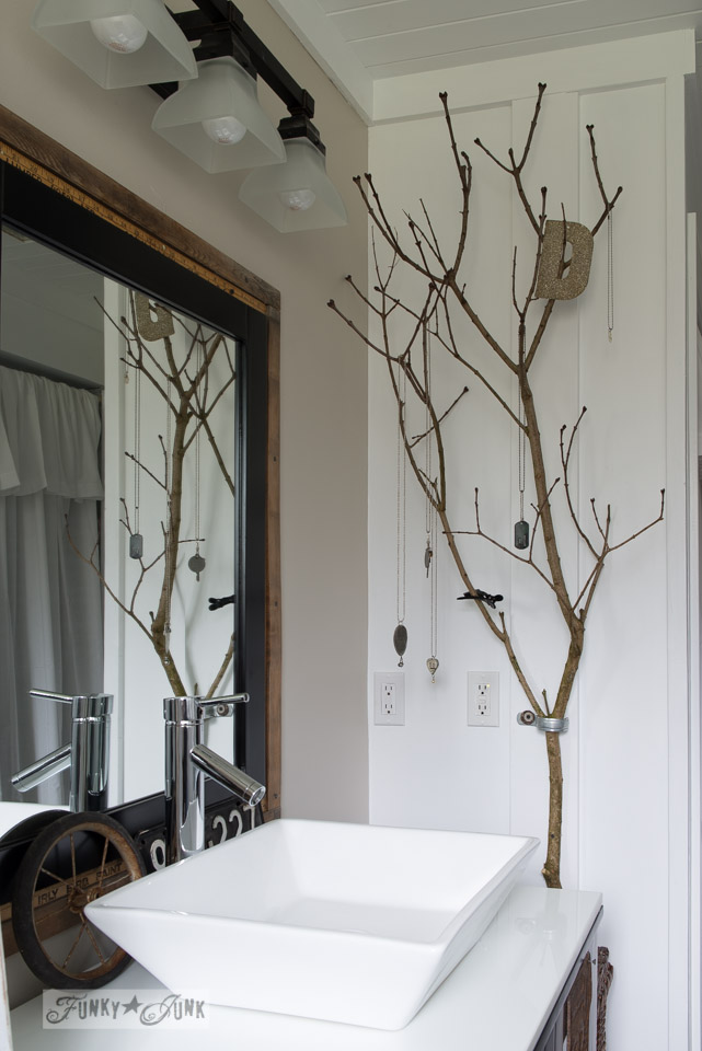 Tree branch jewelry holder in salvaged farmhouse bathroom makeover via FunkyJunkInteriors.net