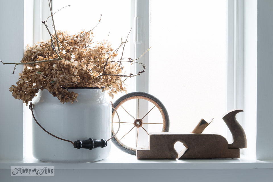 Dried hydrangeas in an enamel pail / window sill decoration via FunkyJunkInteriors.net
