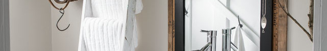 Farmhouse bathroom makeover, with ladder towel bar, vintage window moulding, yardstick mirror