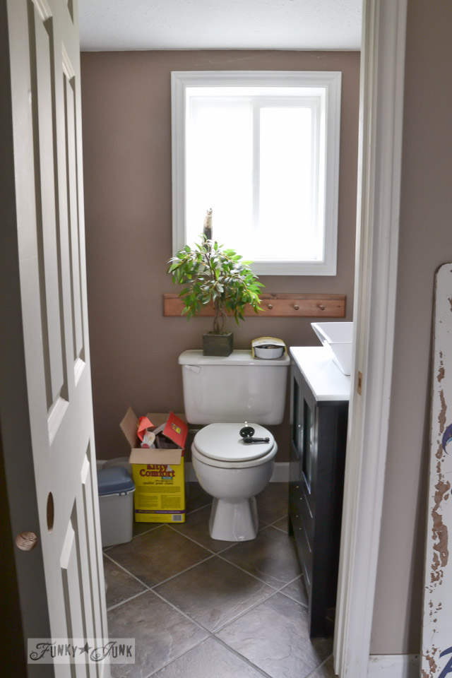 basement bathroom before / how to install a pedestal sink without wall studs via FunkyJunkInteriors.net
