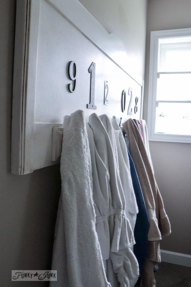 Old headboard towel holder / Master bathroom wins, voice of reason loses... the makings of a new bathroom renovation via http://www.funkyjunkinteriors.net