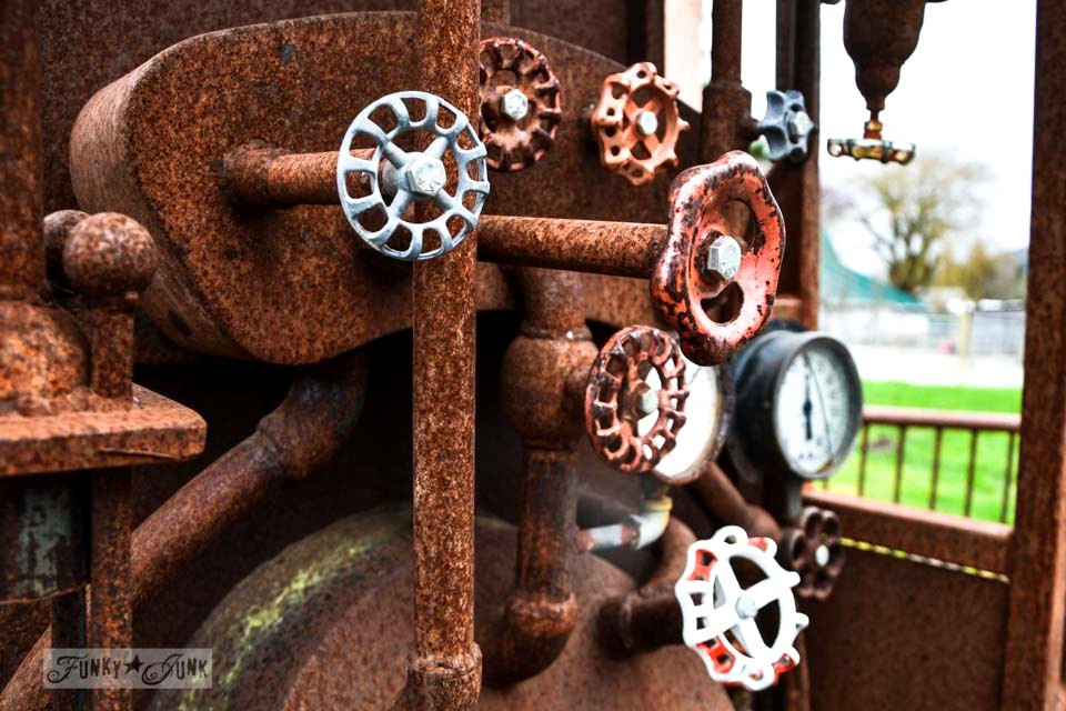 A rusty train with vintage tap handle gears / Someone's got a serious Imagination Corporation! via https://www.funkyjunkinteriors.net/