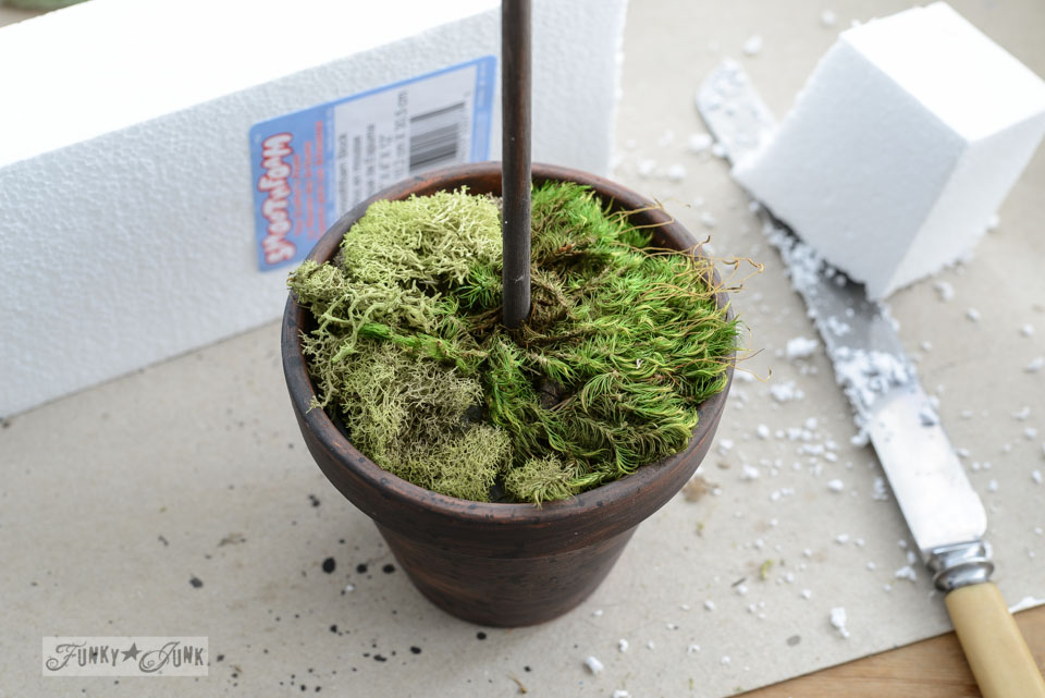 Faux plant in clay pot / How to make inspiring moss topiaries in a crate via FunkyJunkInteirors.net