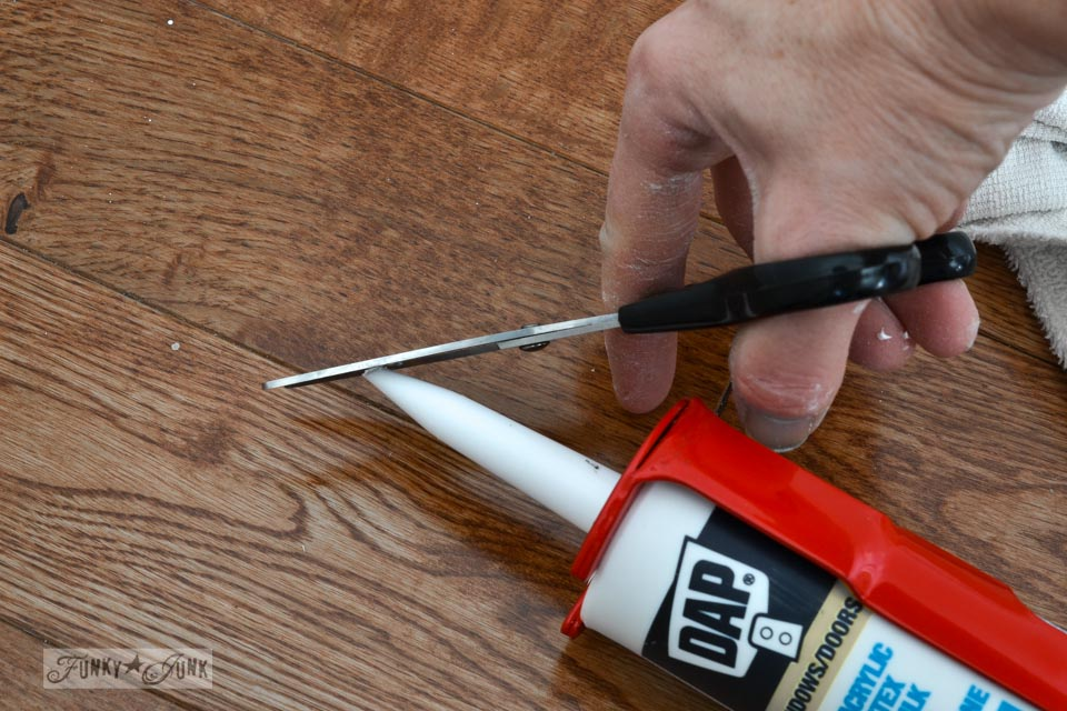 How to cut the tip of caulk / How to plank a bathroom ceiling with pine planks - full tutorial via http://www.funkyjunkinteriors.net/