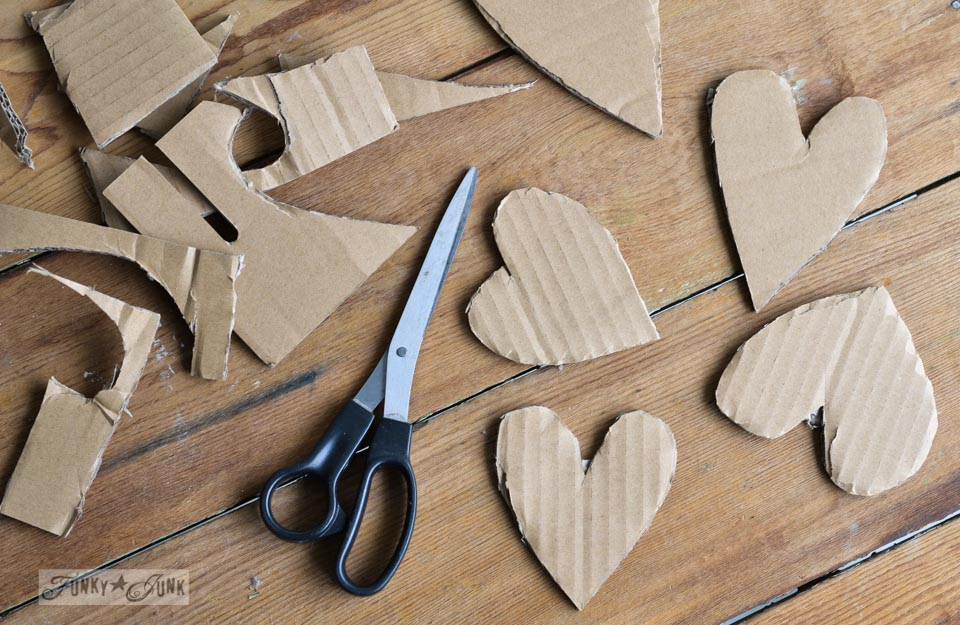 Cardboard cutouts / Learn how to make these charming rustic hearts for Valentine's Day with bark, twine, burlap, buttons, plus! Click for full tutorial with many ideas! #valentinesday #hearts #valentines #funkyjunkinteriors #repurpose
