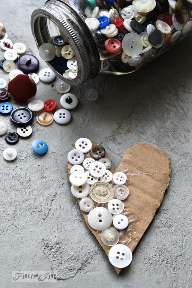 Button covered heart / Learn how to make these charming rustic hearts for Valentine's Day with bark, twine, burlap, buttons, plus! Click for full tutorial with many ideas! #valentinesday #hearts #valentines #funkyjunkinteriors #repurpose #valentinesdayprojects