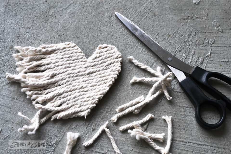 Mop string heart / Learn how to make these charming rustic hearts for Valentine's Day with bark, twine, burlap, buttons, plus! Click for full tutorial with many ideas! #valentinesday #hearts #valentines #funkyjunkinteriors #repurpose