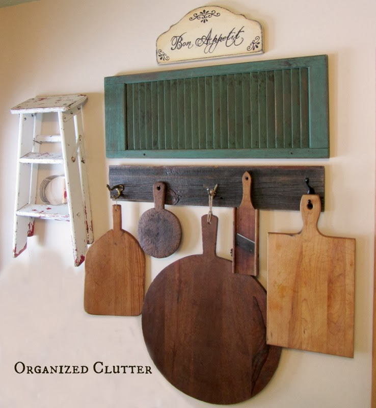 Cutting board wall gallery in kitchen / Organized Clutter