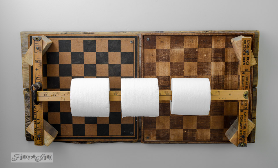 Learn how to make this funky yardstick and checkerboard toilet paper holder that houses 4 rolls of paper! Never run out again.