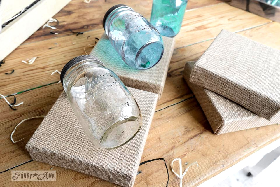 Mason jars on stretched burlap frames via FunkyJunkInteriors.net