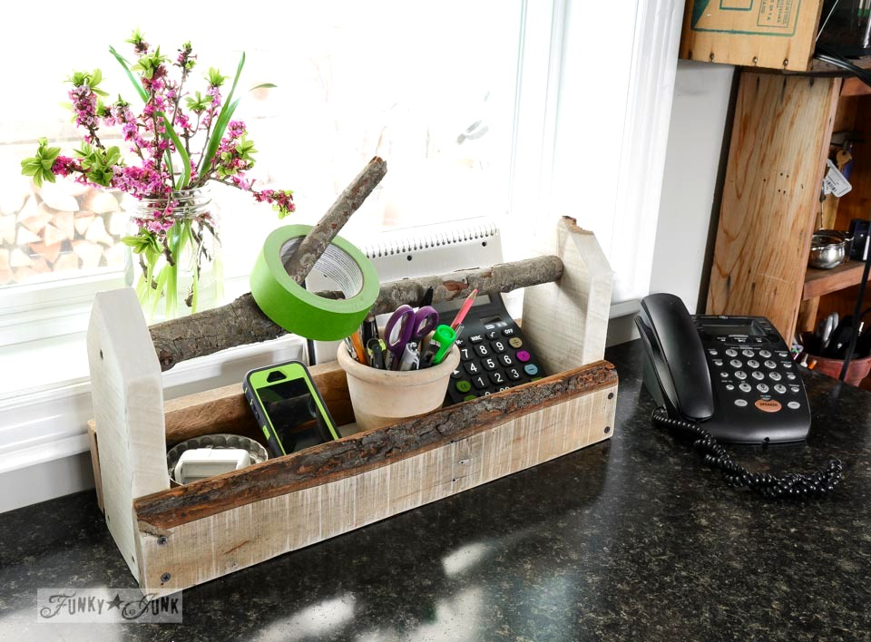 Branch handled toolbox organizer by phone in rustic kitchen via FunkyJunkInteriors.net