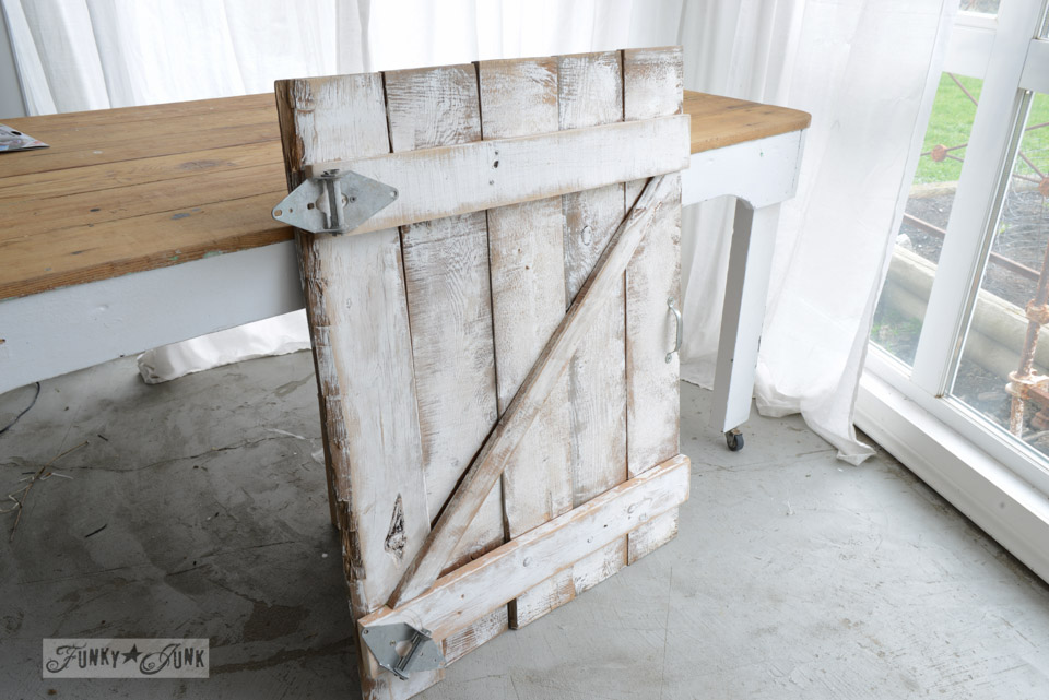 reclaimed wood white washed DIY barn door styled gate for a fireplace mantel | funkyjunkinteriors.net