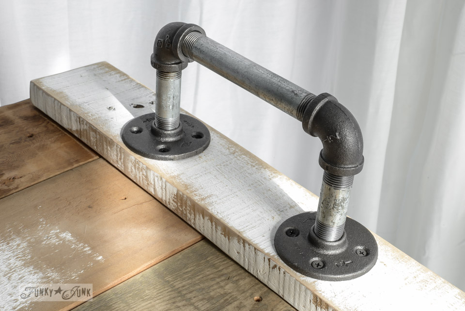 Adding pipe hardware to a reclaimed wood tray / Springing up the bedroom with a pipe handled bed tray, via FunkyJunkInteriors.net
