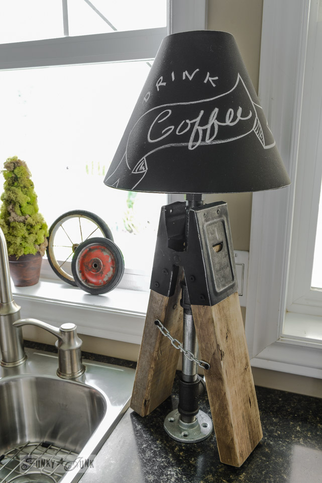 Sawhorse pipe lamp in rustic kitchen via FunkyJunkInteriors.net