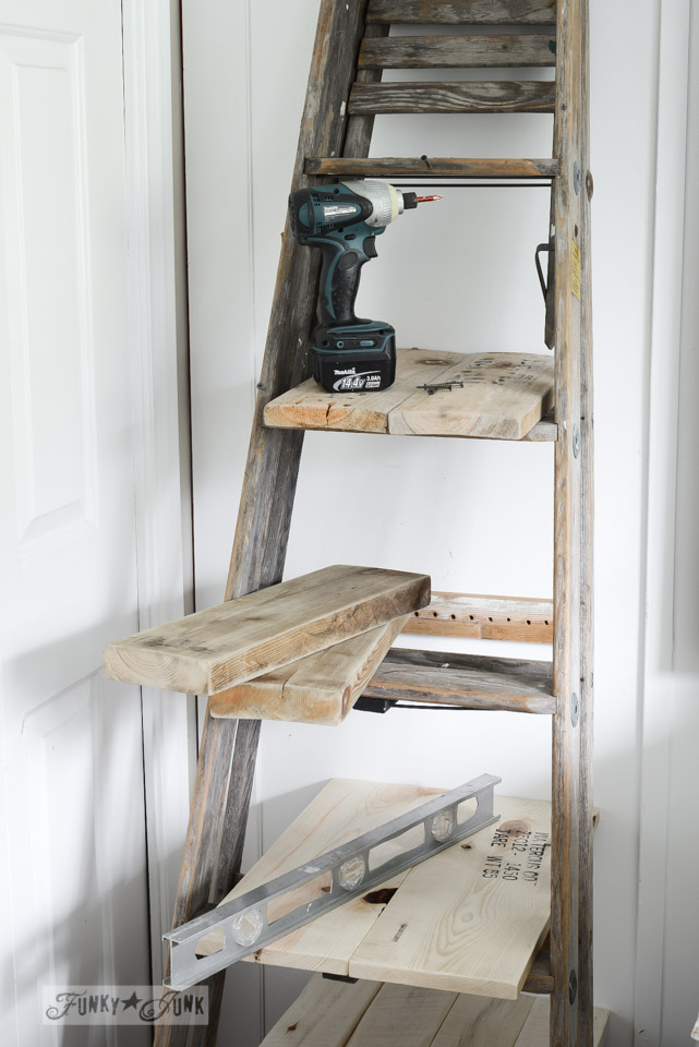 Learn how to build this stepladder side table with scrap wood! Perfect for tall beds and offers loads of space! Click the link for the full tutorial and visit other NEW up-cycled projects!